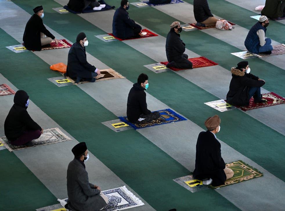 <p>Muslim men take part in socially distanced Friday prayers</p>