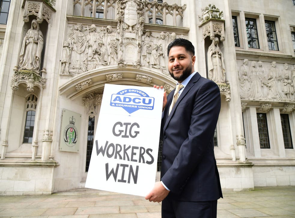 <p>Uber driver Yaseen Aslam outside the Supreme Court, London, on Friday after justices ruled that drivers should be classed as workers, not independent third-party contractors</p>
