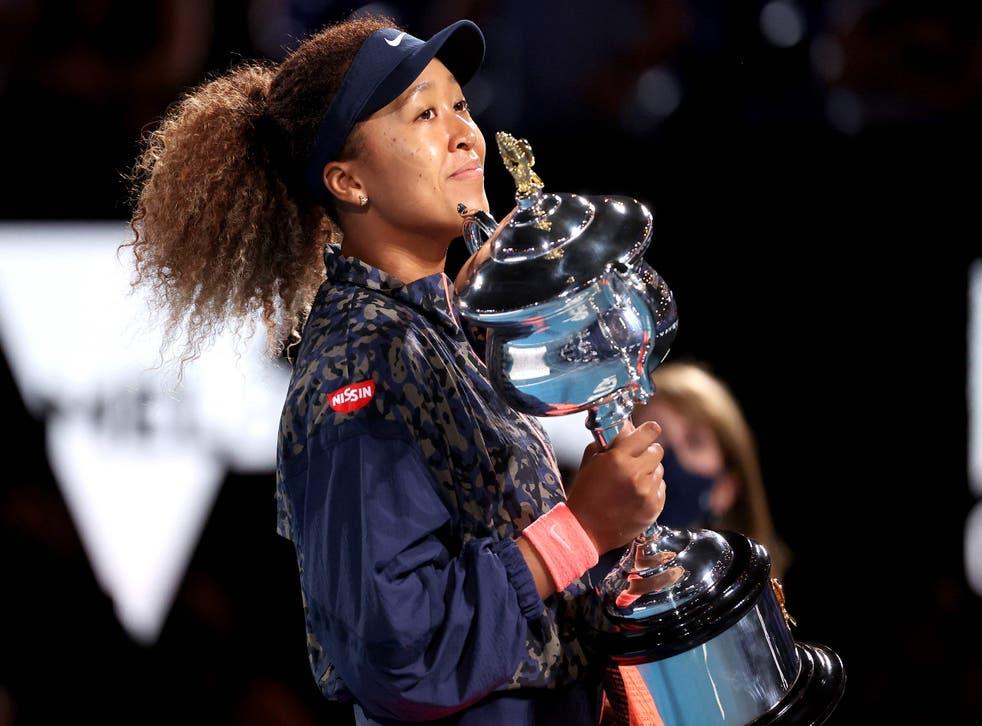 Naomi Osaka clutches the Australian Open trophy