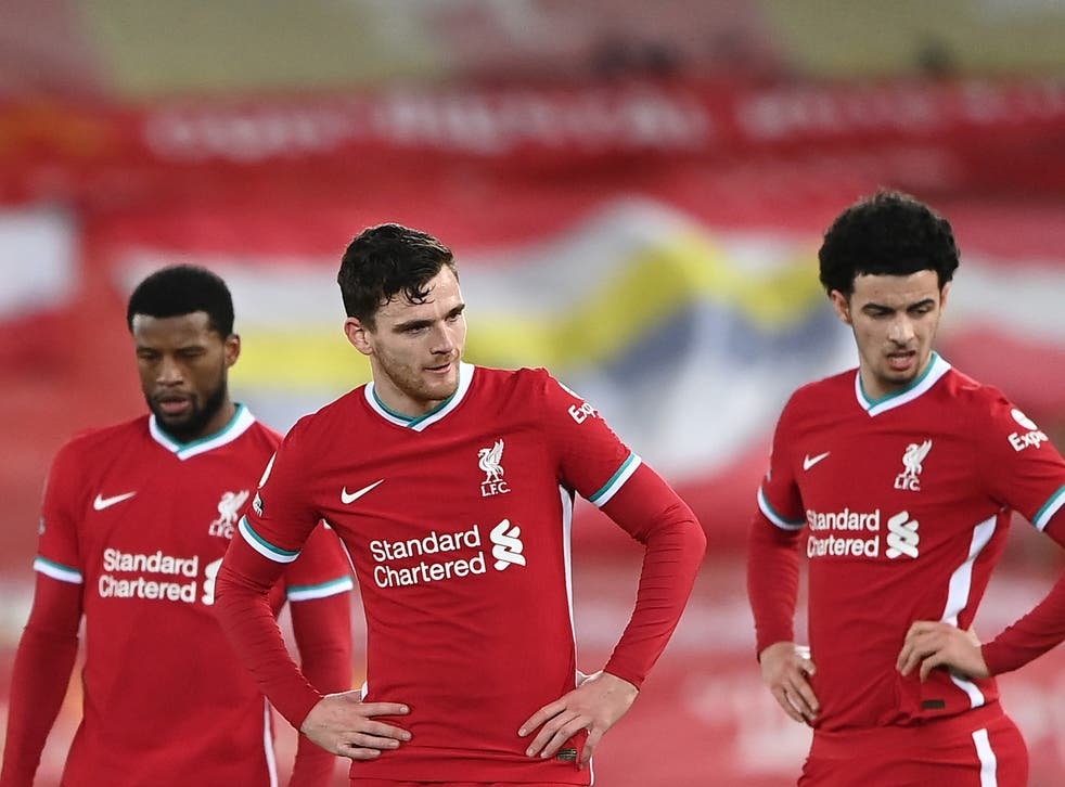 Liverpool players react to their defeat by rivals Everton