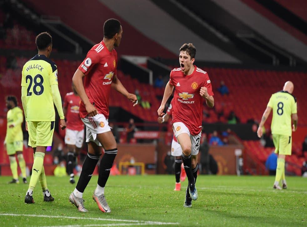 <p>Daniel James celebrates scoring United's second</p>