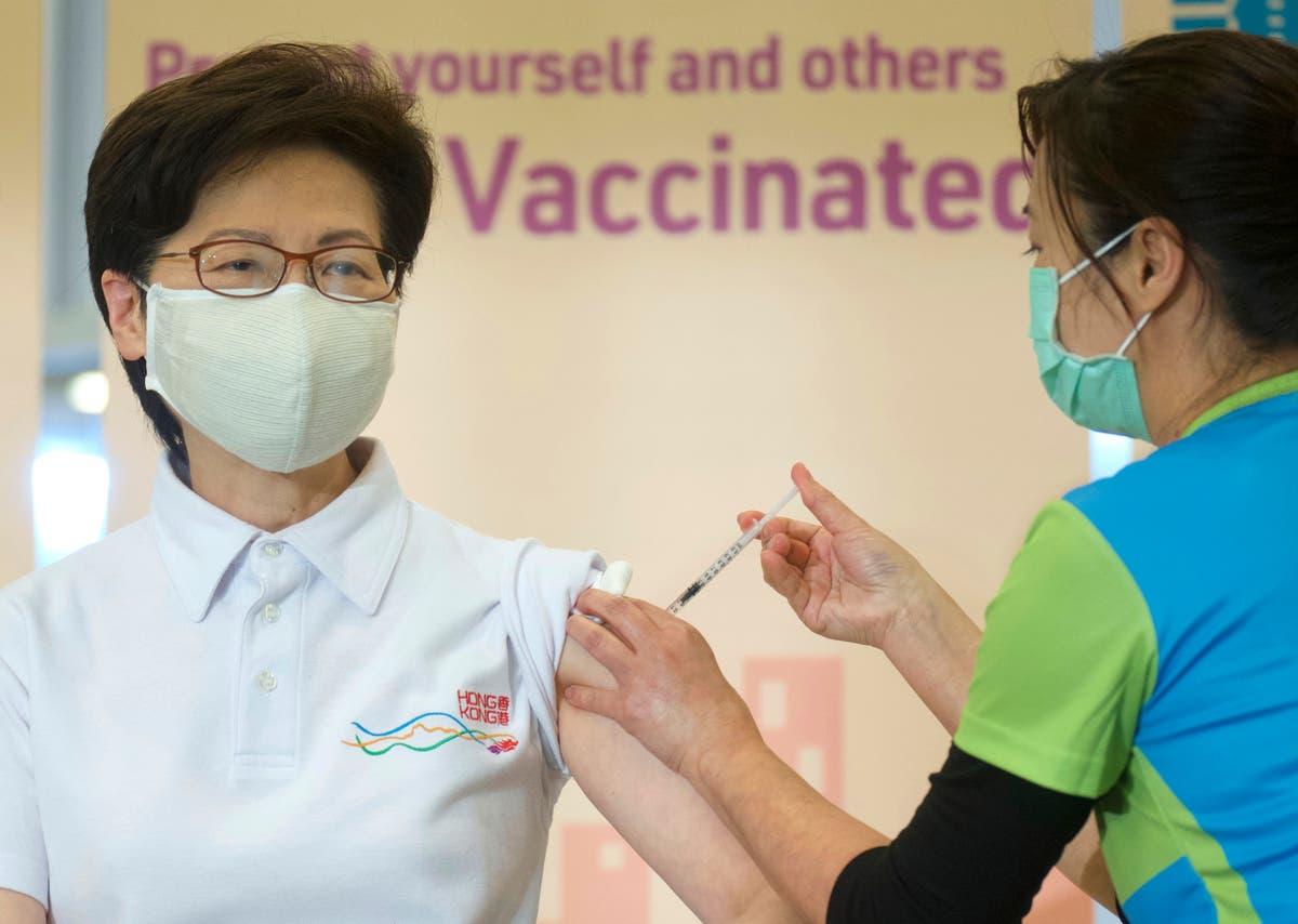 Hong Kong leader, top officials receive COVID-19 vaccine