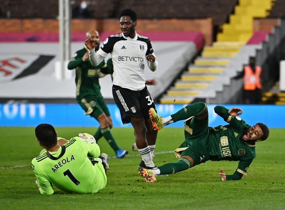 Fulham goalkeeper Alphonse Areola in action with Sheffield United defender Jayden Bogle