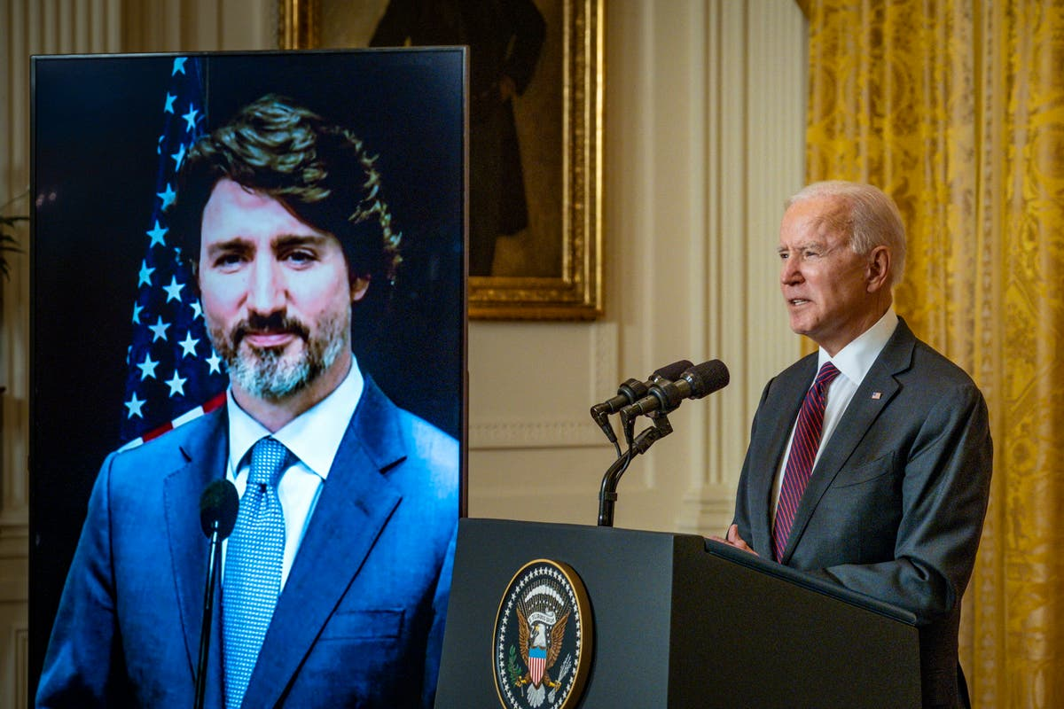 Biden and Trudeau urge world leaders to 'raise their ambitions' as they commit to zero-emissions pledge