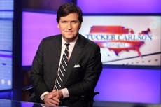 Tucker Carlson mocked for saying he can't find any evidence of QAnon