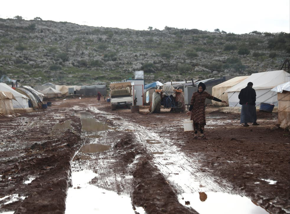 Syrian refugees in a camp near Kafr Aruq, in Idlib province