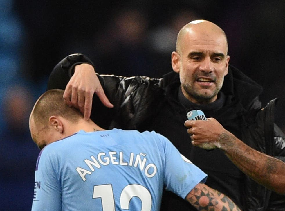 Manchester City manager Pep Guardiola and Angelino
