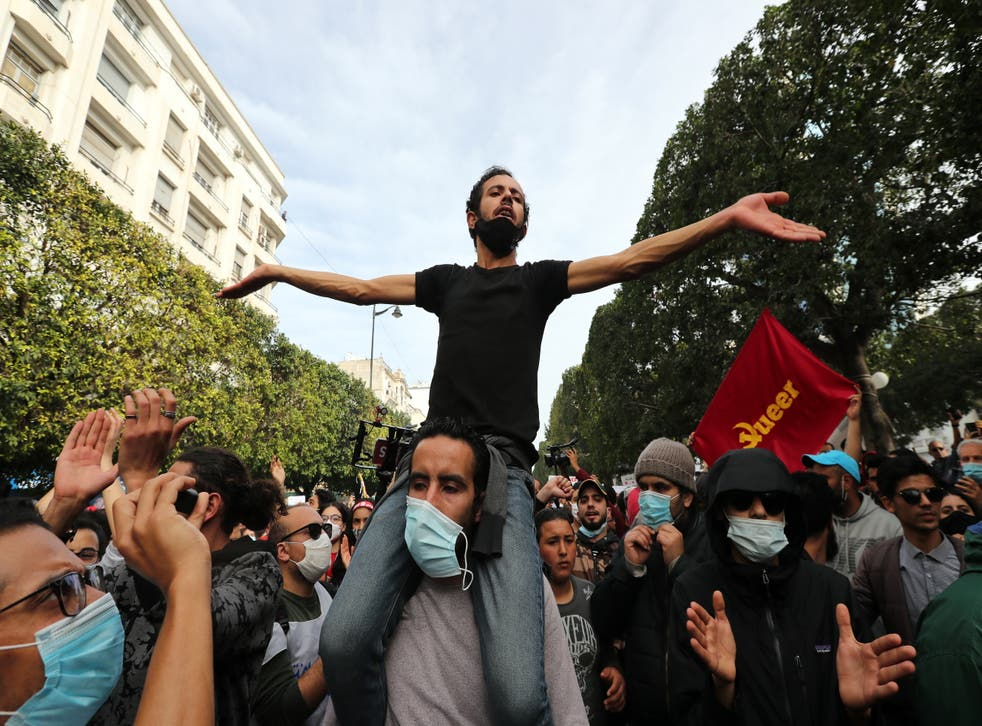 Tunisian anti-government protesters earlier this month on the streets of Tunis