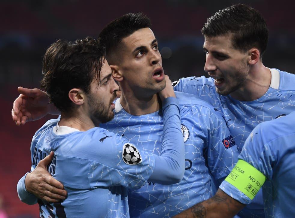 Bernarod Silva and Joao Cancelo celebrate Manchester City's first goal