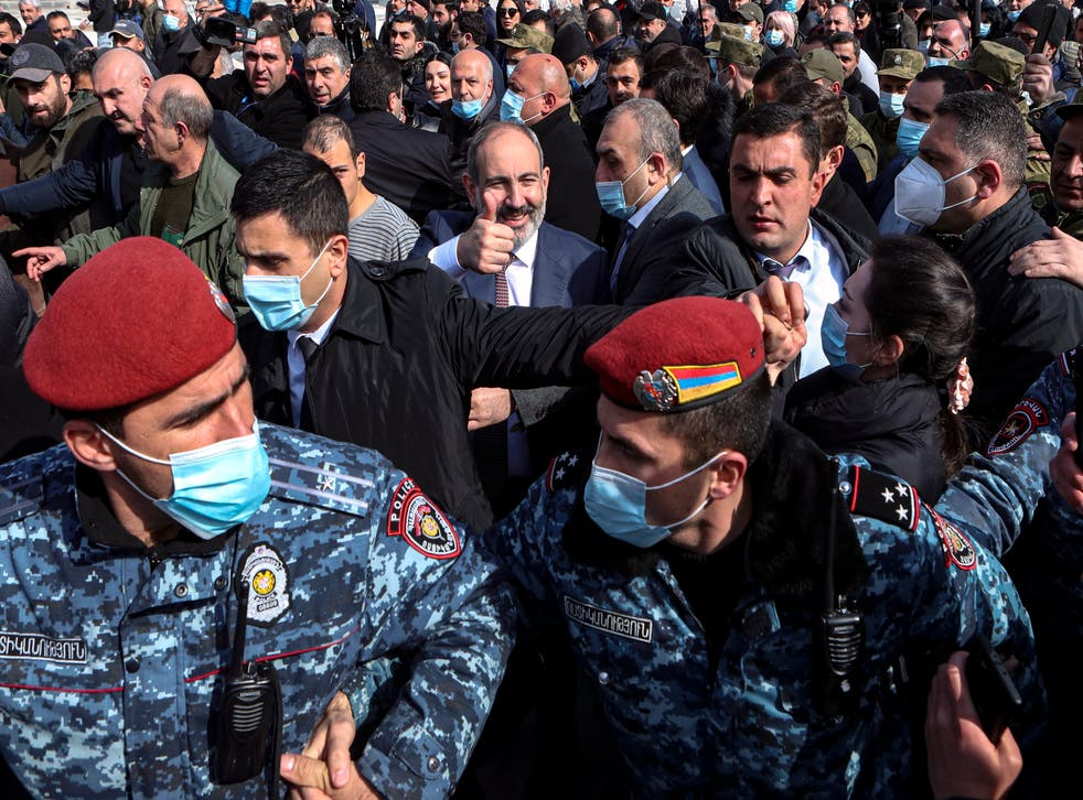 <p>Nikol Pashinyan (centre) greets people while walking with his supporters on the streets in downtown of Yerevan, Armenia</p>