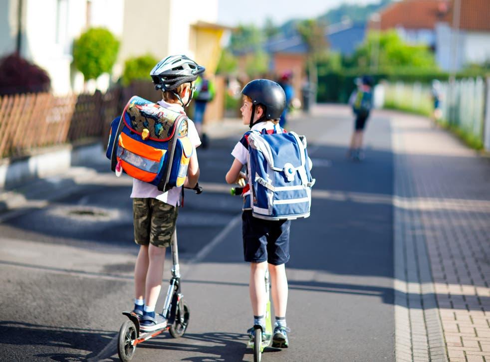 kids scootering to school