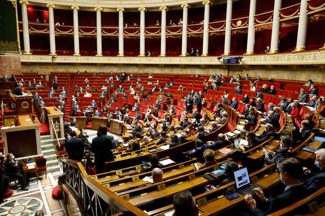 Politicians are shown in the French National Assembly in Paris on 9 February, 2021.