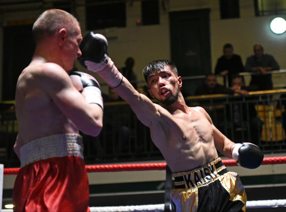Kaisy Khademi (R) defeats Sergey Tasimov