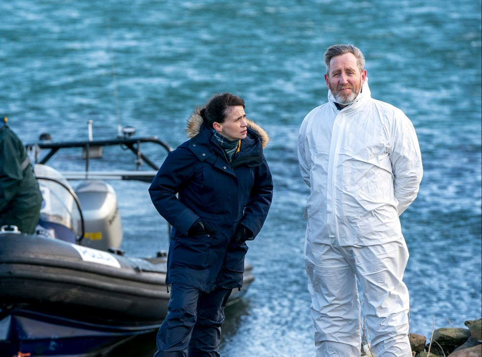 "Niamh McGovern (Charlene McKenna) and ""Dinger"" (Michael Smiley) watch over the forensic team"