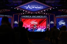 CPAC interrupted as organisers forced to tell attendees to wear masks to furious jeers