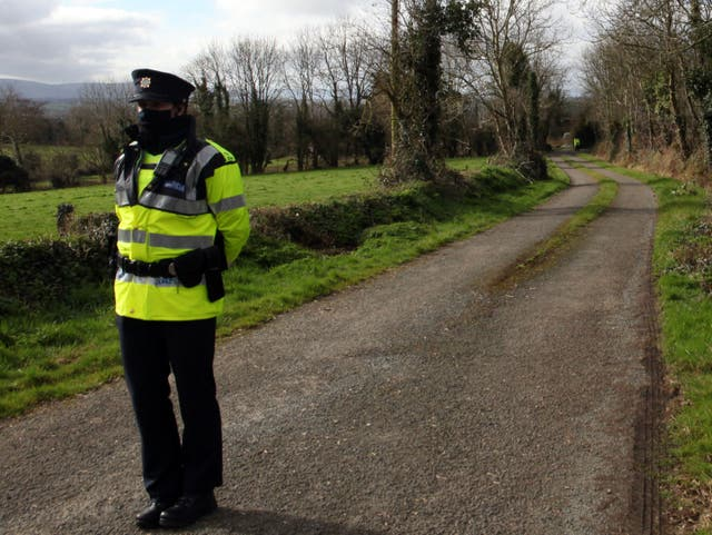 <p>Garda at the scene near Curraghgorm, County Cork, following the deaths of three brothers.</p>