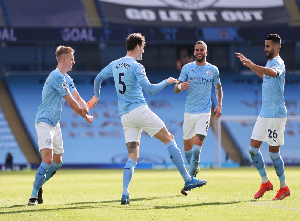 <p>John Stones celebrates with team mates Kyle Walker, Riyad Mahrez and Oleksandr Zinchenko</p>