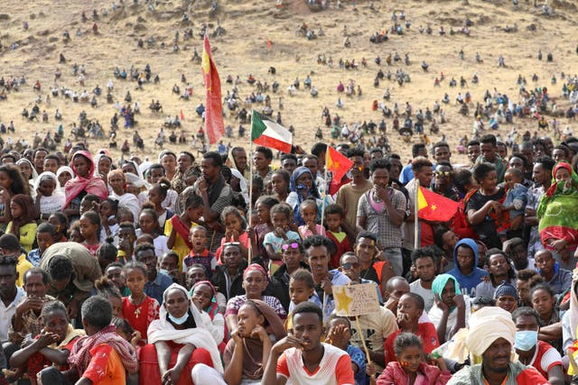 <p>Ethiopian refugees gather to celebrate the 46th anniversary of the Tigray People's Liberation Front at Um Raquba refugee camp in Gedaref, eastern Sudan, on 18 February 2021</p>