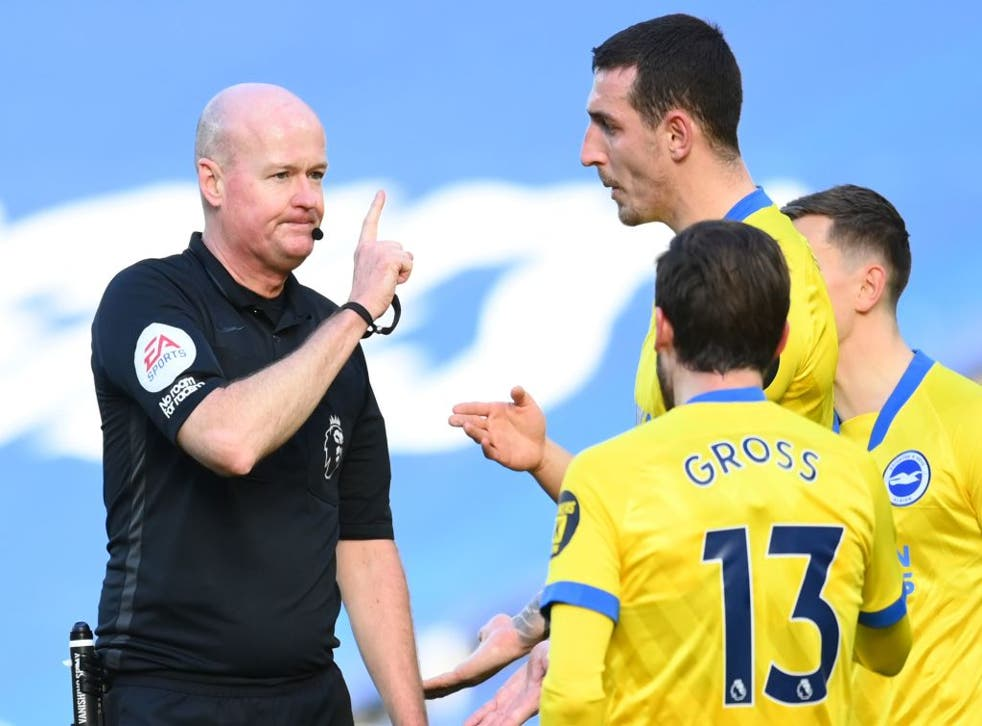 Lewis Dunk remonstrates with Referee Lee Mason