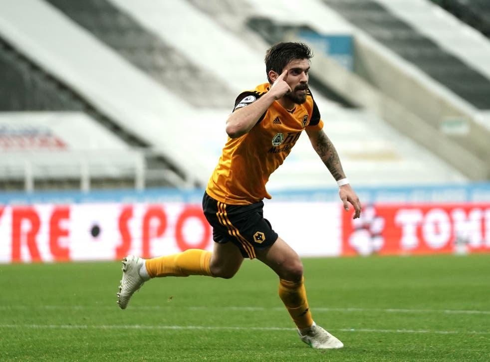 <p>Ruben Neves celebrates scoring the equaliser</p>
