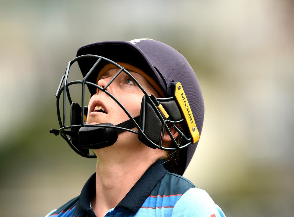 Heather Knight leaves the field after being dismissed