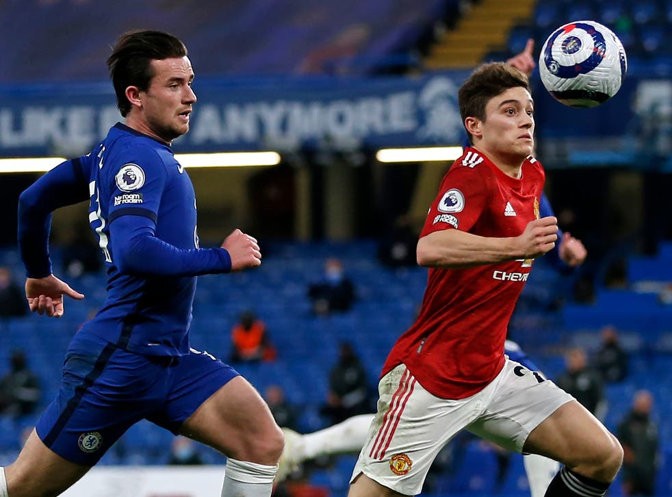 Chelsea's Ben Chilwell and United's Dan James compete for the ball