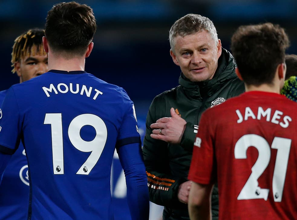 Ole Gunnar Solskjaer interacts with his players and Chelsea's at full-time