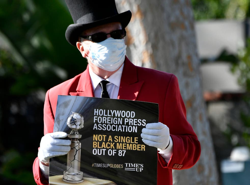 A protester outside the Beverly Hilton on 28 February 2021