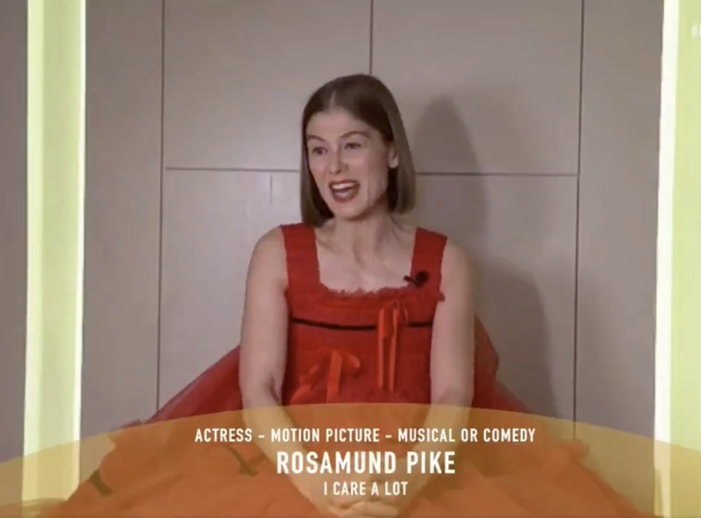 Rosamund Pike collects her Best Actress award at the Golden Globes