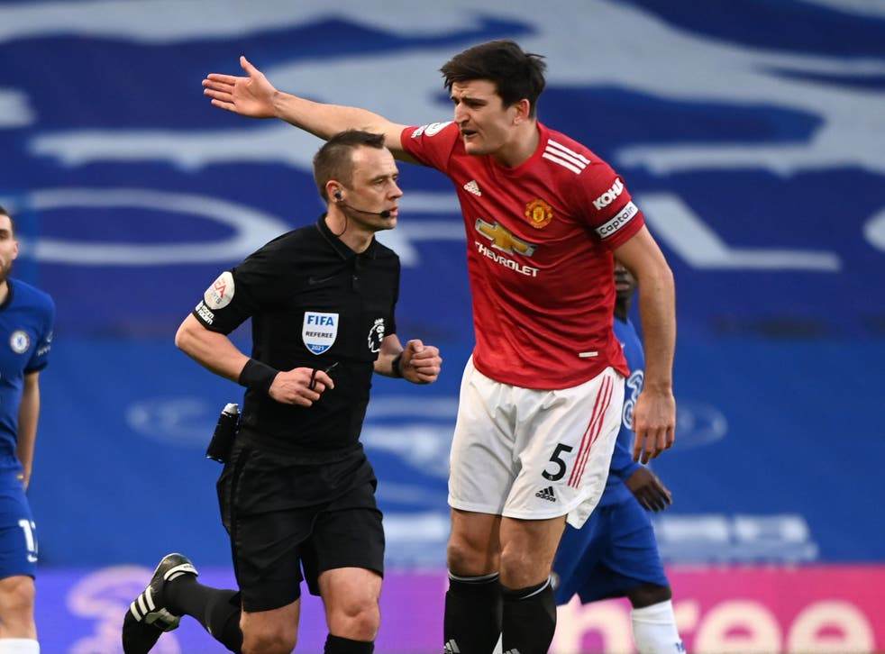 Referee Stuart Atwell and Manchester United captain Harry Maguire