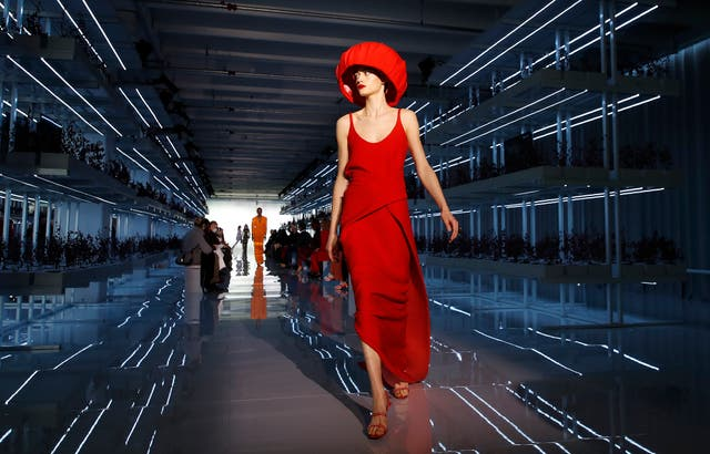 A model wears a creation as part of the Daniel Del Core women's and men's Fall Winter 2021-22 collection, unveiled during the Fashion Week