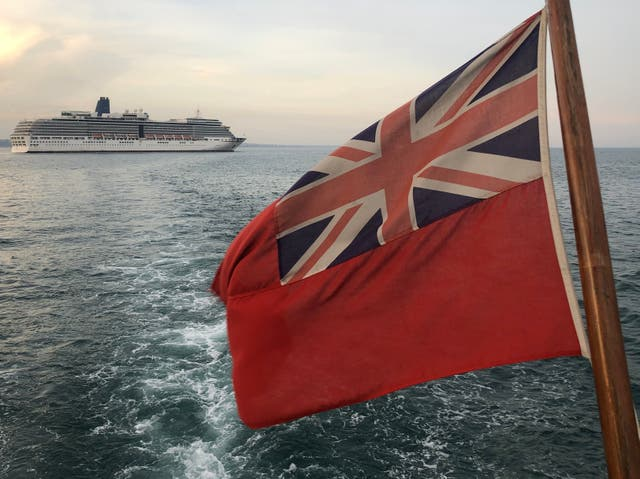 Sailing by: P&O's Arcadia as seen from a pleasure boat off the coast of Dorset
