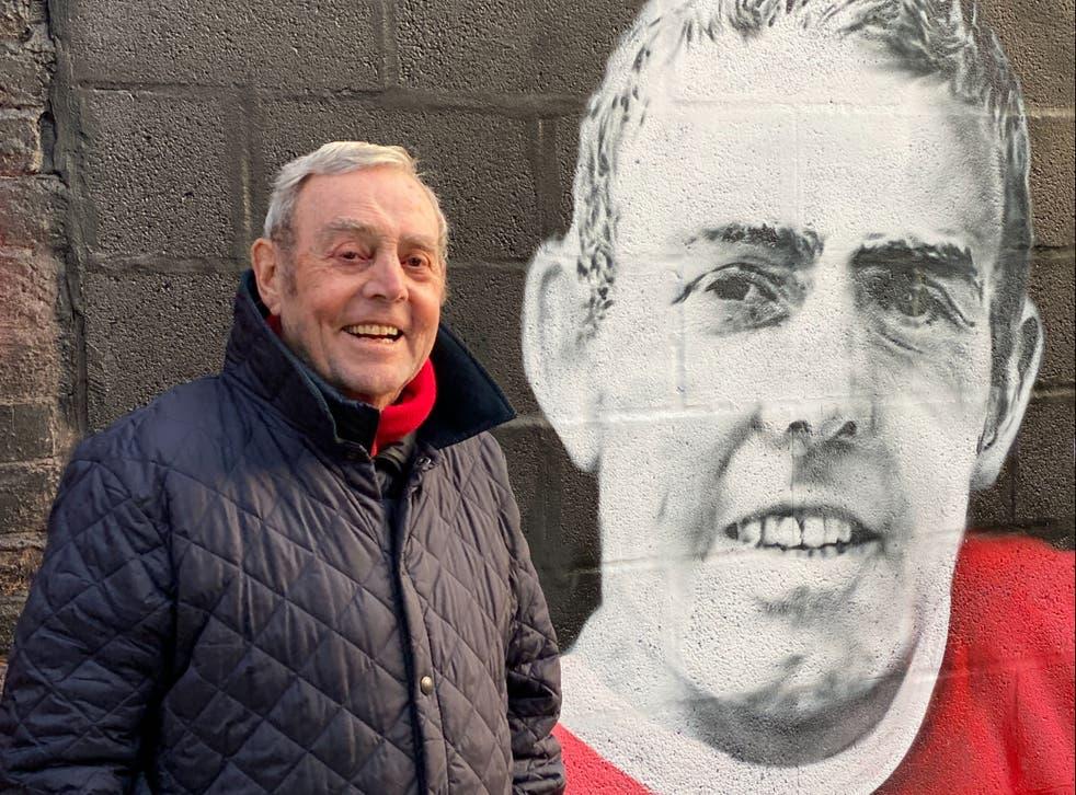 Ian St John pictured alongside a mural of himself