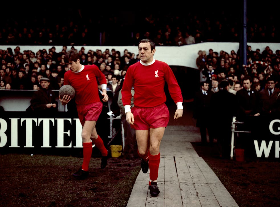 St John (centre) walks out for the Reds in 1969