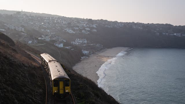 A train rounds the coast and heads towards the Carbis Bay Estate hotel and beach, which is set to be the main venue for the upcoming G7 summit