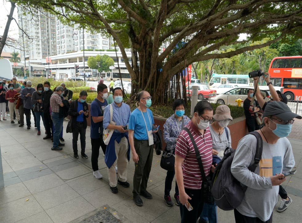 <p>File image - People line up to receive China's Sinovac coronavirus vaccine at a community vaccination centre in Hong Kong on  26 February</p>
