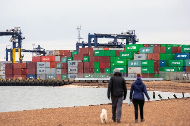 <p>Shipping containers are unloaded from a cargo ship at the Port of Felixstowe in Suffolk</p>