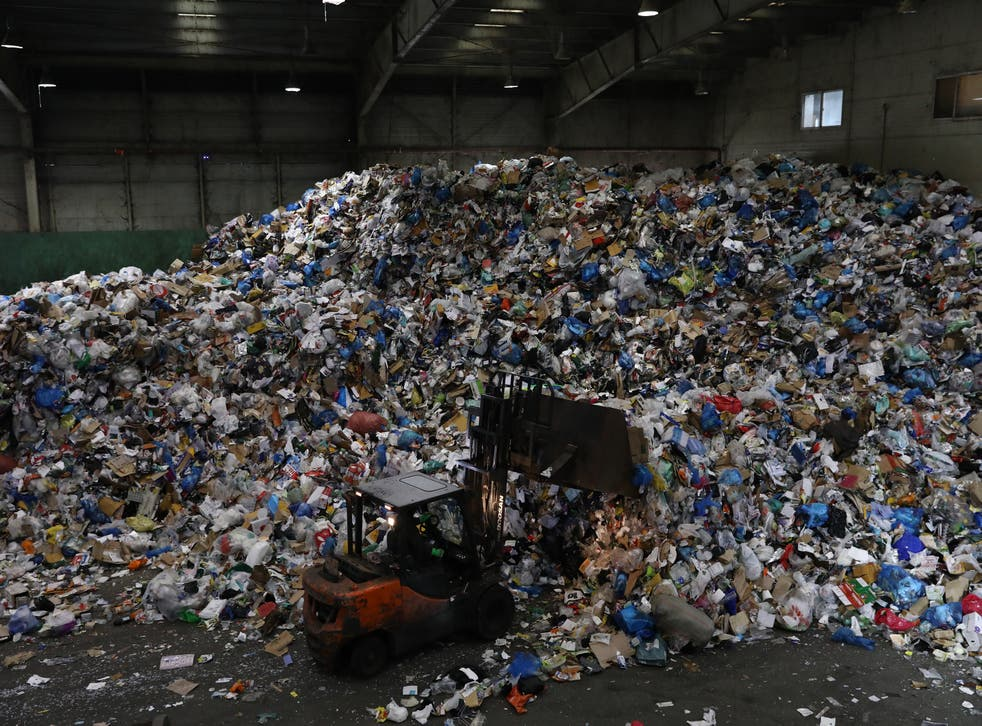 <p> A forklift truck moves household waste at a facility in Seoul, South Korea  </p>