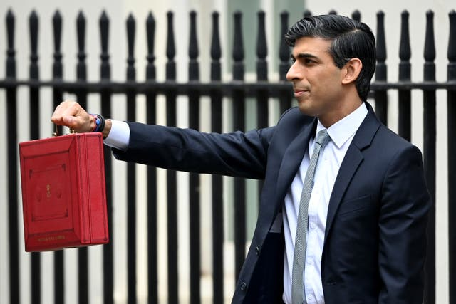 <p>Chancellor Rishi Sunak, holds the budget box before delivering the annual Budget at 11 Downing Street</p>