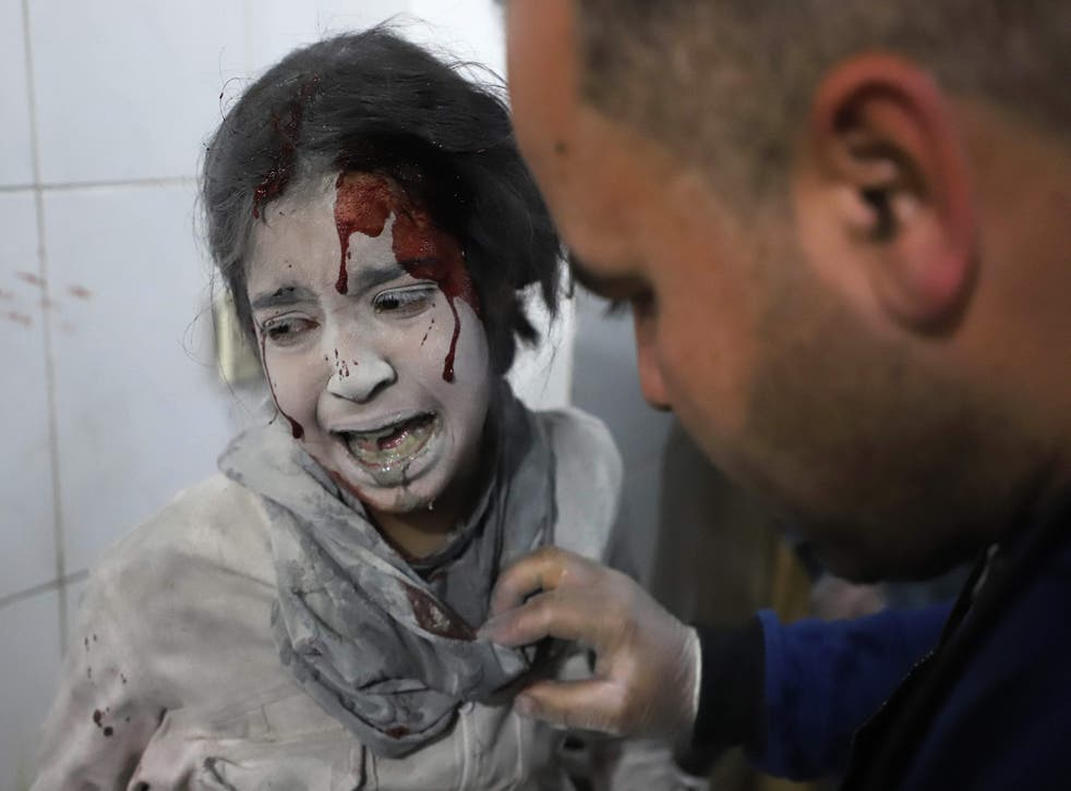 A Syrian girl receives treatment in a makeshift hospital