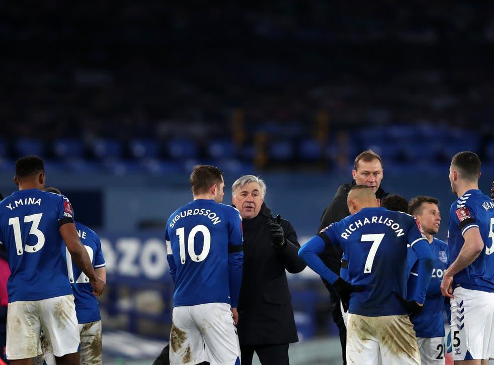 Everton coach Carlo Ancelotti with his players