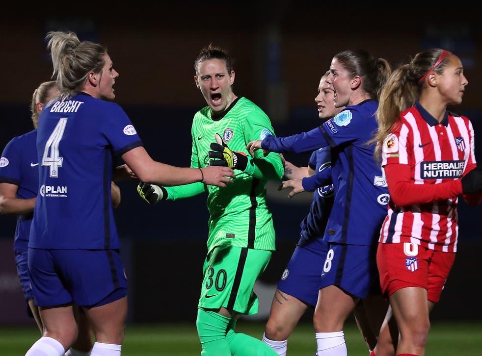 Ann-Katrin Berger celebrates saving a penalty