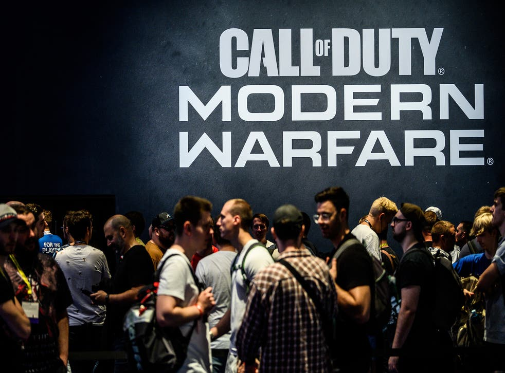 Visitors wait to try out the latest version of Call of Duty Modern Warfare during the press day at the 2019 Gamescom gaming trade fair on August 20, 2019 in Cologne, Germany