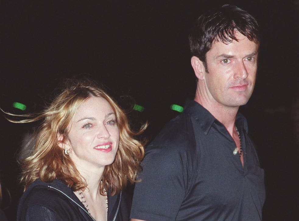 <p>Rupert Everett with some sweaty barmaid (allegedly) at an event in 1999</p>