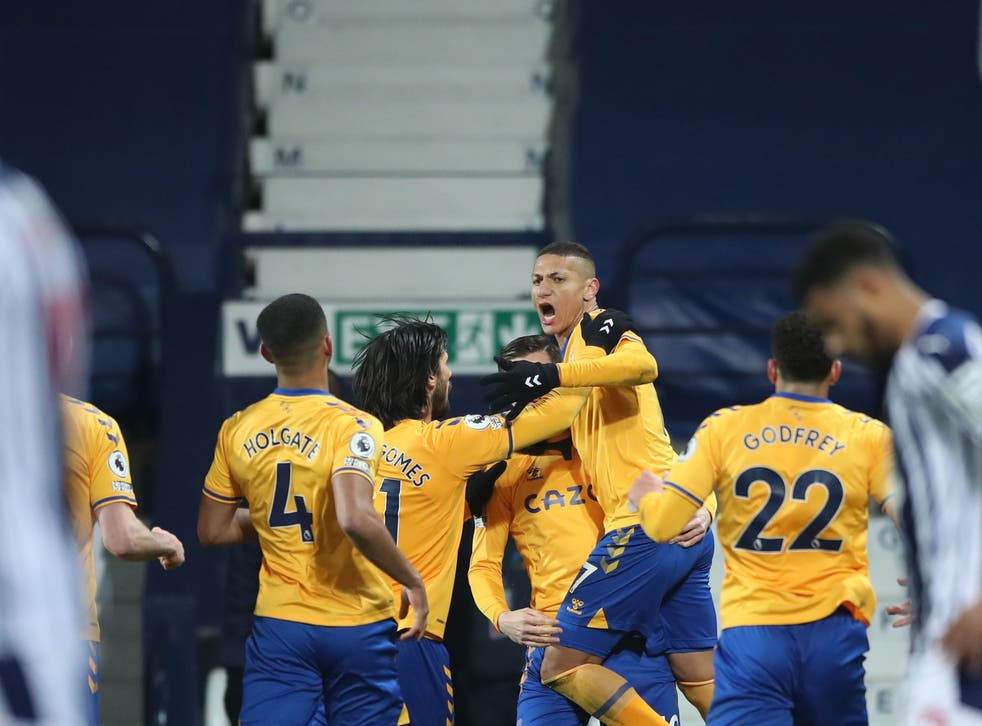 Richarlison celebrates with his team-mates after scoring the winner