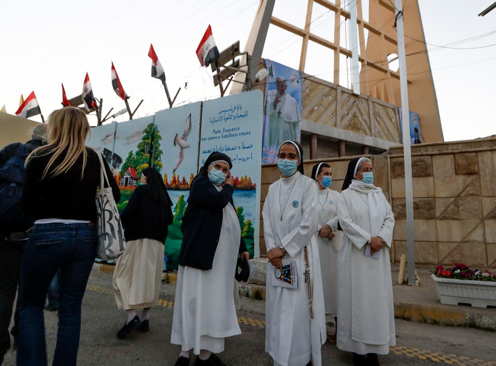 Nuns wait to see Pope Francis outside the Sayidat al-Nejat (Our Lady of Salvation) Cathedral, in Baghdad