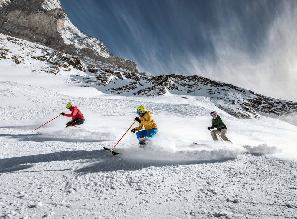 <p>Skiers in Jungfrau.  Resorts are going green to reduce their impact</p>