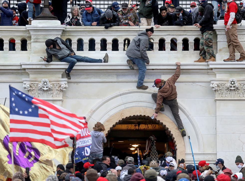 <p>A mob of Trump supporters of storm the US Capitol Building in Washington, DC, on 6 January 2021</p>