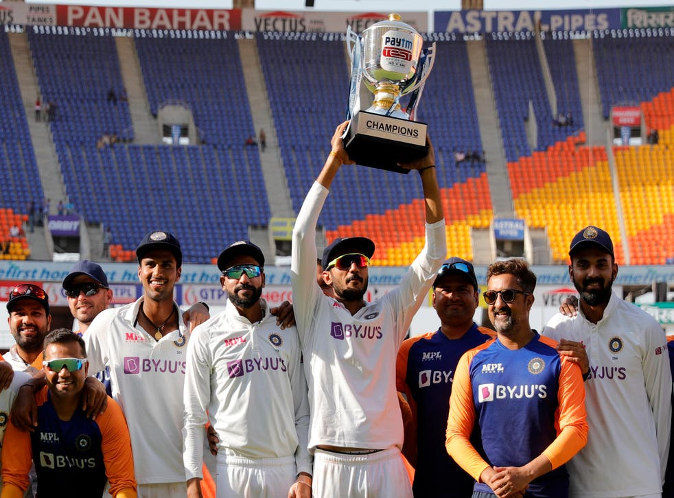 Axar Patel of India raising high the series trophy