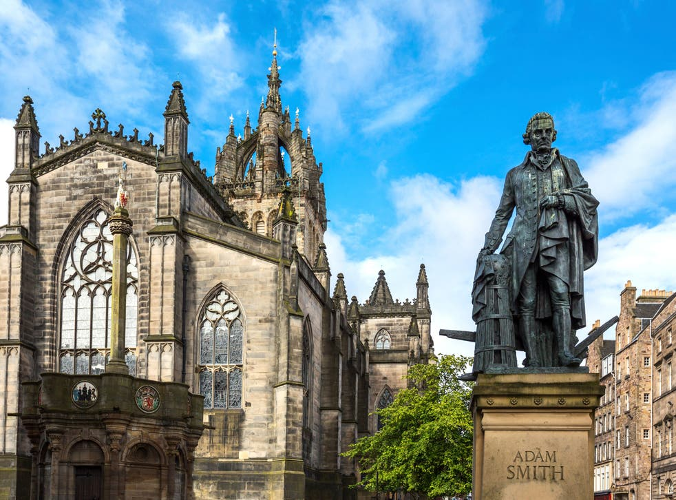 <p>The monument of Adam Smith on the Royal Mile</p>